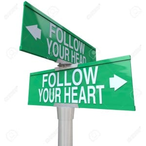 7909311-A-green-two-way-street-sign-pointing-to-Follow-Your-Head-and-Follow-Your-Heart-Stock-Photo